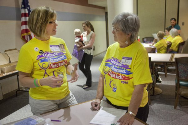 Shelle Arnold, left, and Barb Gorman, right, co-chairs of Relay For Life of Douglas County, visit before a Relay For Life team captain meeting at Lawrence Memorial Hospital, Tuesday, May 22, 2012. Arnold became involved in Relay For Life after losing her daughter-in-law Becky Arnold to Ewing's sarcoma in 2008.