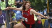 Lawrence High's Rebecca Finley competes in the discus at the Class 6A state meet on Saturday, May 26, 2012, in Wichita.