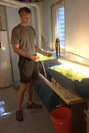 Kirk Devine, Lawrence, his growing system, which uses fish with recycled  water to grow lettuce. Devine&#39;s garden is part of the annual Lawrence Food Garden Tour this Saturday, June 2.