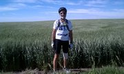 Former Lawrence mayor John Nalbandian stands next to a field en route to Colby during his previous trip with Biking Across Kansas in 2010. He plans to take part in the ride again this summer.