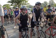 From left in foreground, friends Lexy Quandt, Council Bluffs, Iowa, and Lisa Rasor, Lawrence, wait with 300 other bicyclists for the start of the 36th annual three-day Cottonwood 200 ride May 26. Like many cyclists, Rasor and Quandt use the Cottonwood ride to prepare for the 8-day, 475-mile Biking Across Kansas, which they will participate in June 9-16.