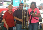 Pig Newton, a team out of Kansas City, Kan., won grand champion honors Saturday at the McLouth BBQ Blowout. Pictured are event advertising coordinator Cheryl Wonnell, left, Mike Castaneda, center, and Betty Castaneda.