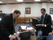 Attorneys John Robb and Alan Rupe, representing plaintiff school districts, prepare for opening of school finance hearing in Shawnee County Courthouse.