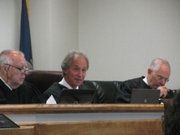 Hearing the school finance case are from left to right Judges Robert Fleming, Franklin Theis, and Jack Burr.
