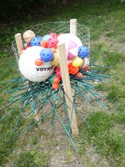 A lawn-game version of Kerplunk can be made out of simple supplies from the hardware store and balls borrowed from other games.