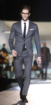 A model wears a creation from the Dsquared2 men's Fall-Winter 2012/2013 collection, part of the Milan Fashion Week, unveiled in Milan, Italy, Tuesday, Jan. 17, 2012. Help out your wedding date by suggesting an outfit. A suit is generally appropriate.