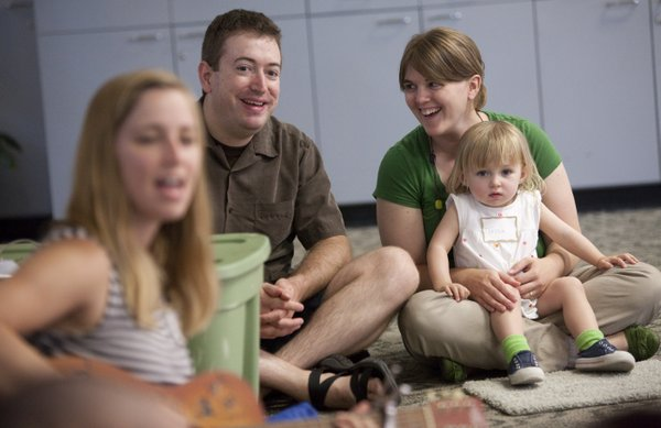 Sara Vancil laughs with her husband, Brian Vancil, as the two sing with their 2-year-old daughter, Tessa, during a children's sing-along class at the Lawrence Indoor Aquatic Center on Tuesday, June 5, 2012. Immediately after Tessa was born, Sara experienced a severe case of postpartum depression that lasted about three months.