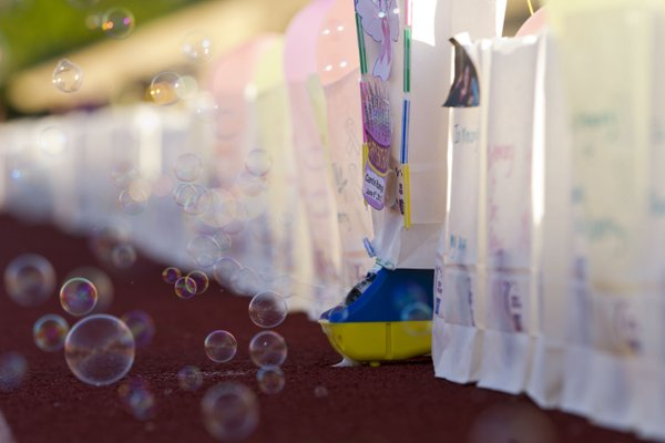 A bubble machine helps decorate a luminary honoring Carrie Rangel during the 2012 Relay for Life of Douglas County event.