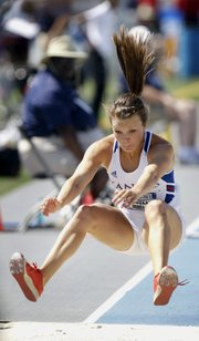 Kansas' Andrea Geubelle leaps to the pit during the women's triple jump at the NCAA outdoor track and field championships, Saturday, June 9, 2012, at Drake Stadium in Des Moines, Iowa.