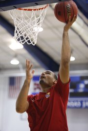 Freshman Perry Ellis puts in a layup as he works out for the campers during Bill Self's basketball camp on Monday, June 11, 2012, at the Horejsi Center.