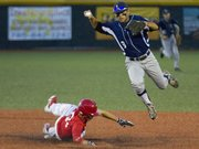 Raider's shortstop Corbin Francisco, right, avoids a sliding Kyle Burton after making the out at second base during Lawrence's game against the Topeka Capitals Tuesday, June 12, 2012 at Free State. The Raiders lost, 4-3.