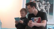 Blink 182 bassist Mark Hoppus and his son, Jack, play Nintendo DS while filming The Other F Word.