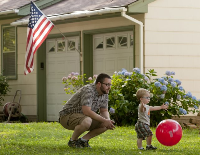 Kyle Stern watches as his 19-month-old son Sam play in the front yard of their Kansas City home. Stern and his wife both experienced a postpartum mood disorder after their son was born.
