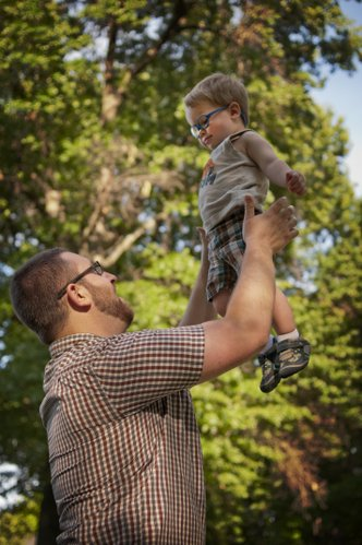 Kyle Stern plays with his 19-month-old son Sam recently in the yard of their Kansas City home. Kyle and his wife, Amelia, experienced postpartum depression after their son was born.