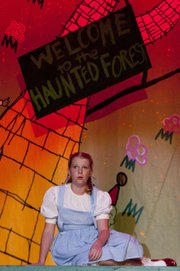 "Dorothy, played by Carter Stacey, sings as she is held captive in the Wicked Witch of the West's castle during a dress rehearsal of ""The Wizard of Oz"" Thursday, June 14, 2012, at the Lawrence Arts Center, 940 N.H."