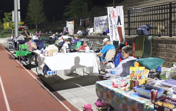 "About midnight, Relay For Life of Douglas County participants hang out in the their ""camping"" areas on the Free State High School event. The overnight event, June 8-9, raised money for the American Cancer Society."