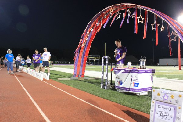 Longtime Lawrence doctor Rod Barnes talked about his battle with leukemia and bone marrow transplant before the luminaria ceremony at Relay For Life of Douglas County.