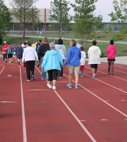 Barb Gorman, left, and Shelle Arnold, co-chairs of Relay For Life of Douglas County, walk their last lap around the track during the event, which raises money for the American Cancer Society. Gorman is a cancer survivor and Arnold relays for her daughter-in-law Becky Arnold who died from a rare form of bone cancer at age 27.