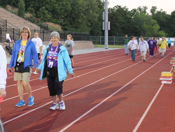 In foreground, Shelle Arnold, left, and Barb Gorman walk their last lap at Relay For Life of Douglas County. The two spent countless hours organizing the event as co-chairs. The event raises money for the American Cancer Society. They were co-chairs in 2011 and plan to do it again next year.