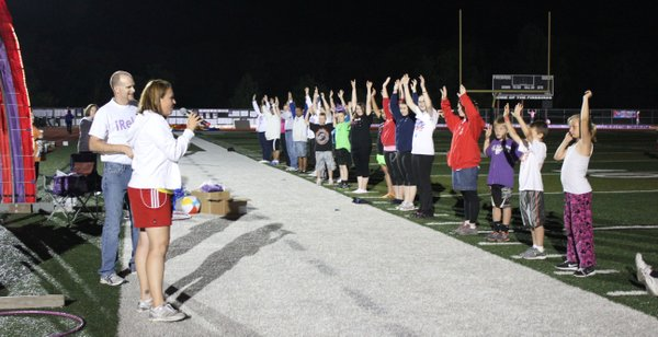 "Relay For Life of Douglas County participants play ""Simon Says"" in early morning hours. The overnight event raises money in the fight against cancer."