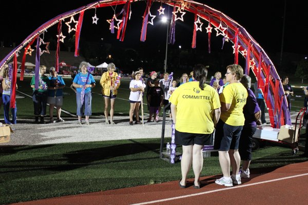 Relay For Life of Douglas County participants hold their team's spirit sticks as the judges decide on a winner.