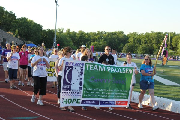 Team Paulsen makes it way around the track during Relay For Life of Douglas County.