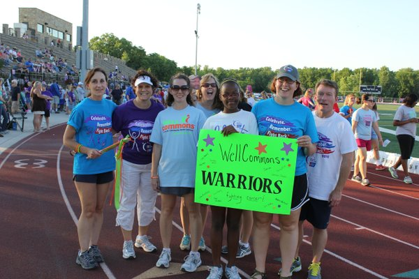 The WellCommons Warriors team stops for a picture after making its first lap at Relay For Life of Douglas County.