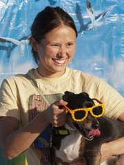 Andrea Allen poses with Ernie, a corgi/basenji, at Barkarusafest held Friday, June 15, 2012 in the parking lot outside of Pawsh Wash at the corner of Bob Billings Parkway and Wakarusa. The event, which featured fun, food and live music, was a fundraiser for the Lawrence Humane Society.