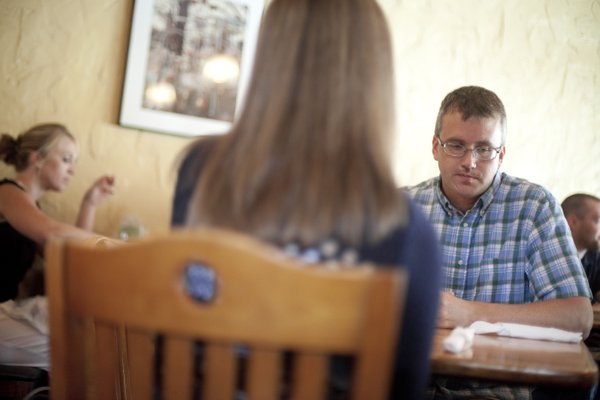 Aaron Polson searches for words as he talks about how his oldest sons are coping with the death of their mother during a lunch with Melissa Hoffman, Kansas coordinator for Postpartum Support International during a lunch meeting on Thursday, May 31, 2012, at Free State Brewery.