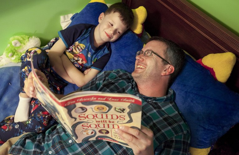Aaron Polson laughs with his son Max, as he reads the 6-year-old a story before bed on Thursday, June 7, 2012.