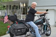 Tom Steele, Basehor, says he'd rather spend his time on his Harley or with grandkids than frittering it away on the Internet.
