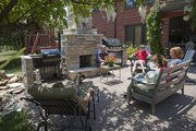 The Wildeman family has a large patio that includes a cooker, grill and fireplace area as well as an outdoor kitchen nearby. Pictured on the patio from left are Ashley, Terry, Garrett, Morgan and Sheila Wildeman. Terry, a carpenter, built the fireplace.