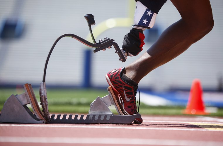 Clemons takes off from the blocks as he trains for the Paralympic Games, Monday, June 18, 2012 at Memorial Stadium.