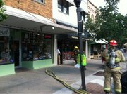 Crews respond to a fire reported in the apartment above Pickleman's, 818 Mass.