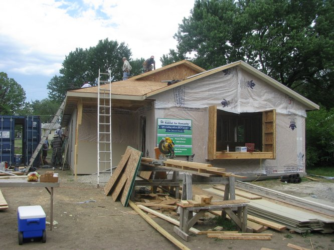 Work continues on Lawrence Habitat's 80th home on Saturday.