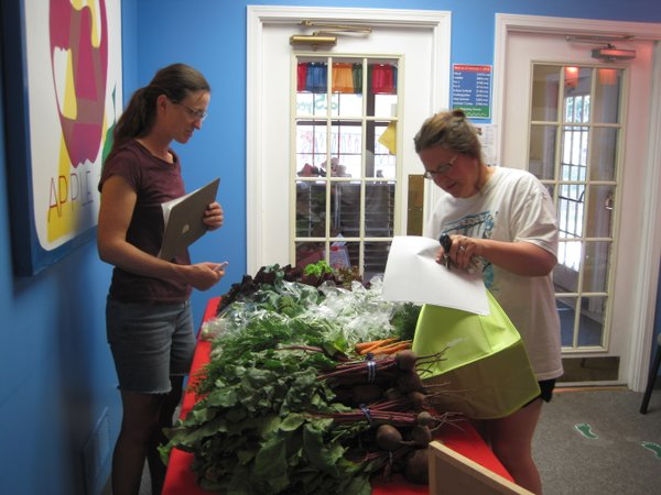 Farmer, Jenny Buller and subscriber at Stepping Stones Child Care's CSA
