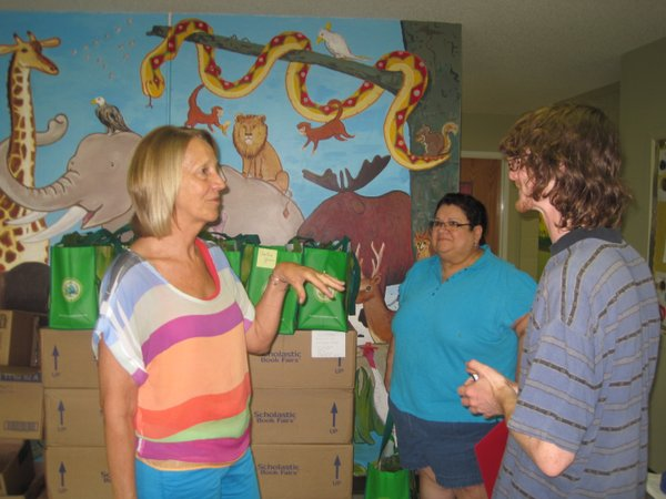 Children's Learning Center director, Holly Turner chats with farmer, Rolf Petermann at the first CSA drop-off