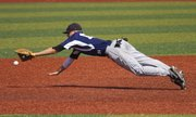 Lawrence Raiders third baseman Aaron Gile dives for the ball during the Raider's game against Manhattan Saturday, June 23, 2012 at Hoglund Ballpark