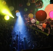Mike Yoder/Journal-World Photo.Strobing spotlights and large balloons drift over a full house at Liberty Hall Friday night as the The Flaming Lips kicked off a Liberty Hall 100-year anniversary celebration concert..