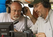 Norm Mast, Ottawa, left, and Fred Gantz, Lecompton, contact radio operators around the world during the Douglas County Amateur Radio Group's Field Day on Saturday.