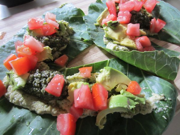 Unrolled collard wraps with zucchini hummus and hemp seed and basil pesto.
