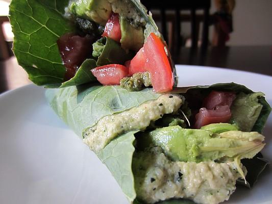 Collard wraps with zucchini hummus, hemp seed and basil pesto, avocado and local tomatoes.