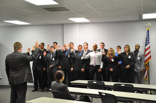 New Lawrence Police Department recruits are sworn in Tuesday. The recruits will begin training as part of the department's sixth-month academy before they start patrolling the streets.