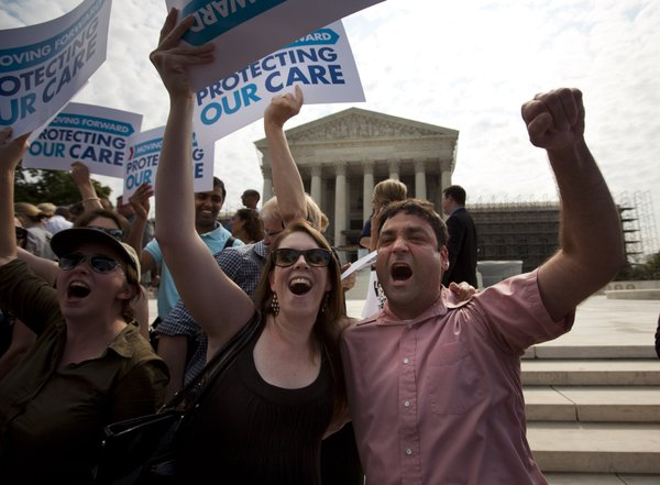 Claire McAndrew of Washington, left, and Donny Kirsch of Washington, celebrate outside the Supreme Court in Washington, Thursday, June 28, 2012, after the courts's ruling on health care.