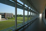 Three floors of the hallways with glass walls inside the BEST Building offers viewers a spot to see Regnier Hall across the field to the south at the KU Edwards Campus in Overland Park.
