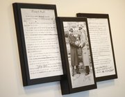 """A copy of the Dr. James Naismith&squot;s original rules of basketball are displayed along with a photo of Naismith and """"Phog"""" Allen in the athletic offices. The design is one of Acker&squot;s more recent."""