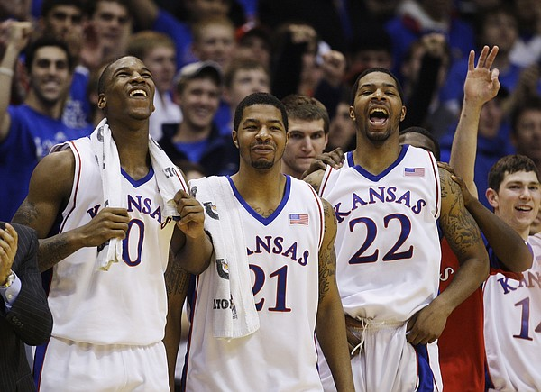 Former Kansas University players Thomas Robinson (0), Markieff Morris (21) and Marcus Morris (22) watch the action during a game against California in this file photo from Dec. 22, 2009 in Allen Fieldhouse.