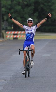 Sean Sullivan of the Elbowz Racing team celebrates with no riders in sight to take the Kansas University Campus Circuit race on Saturday, June 30, 2012, on the hilly and hot KU campus.