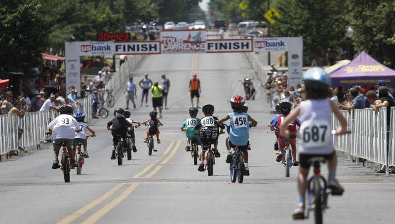 Children speed to the finish line during the Kids' Bike Races at Sunday's Tour of Lawrence events and the Free State Brewery Downtown Criterium.