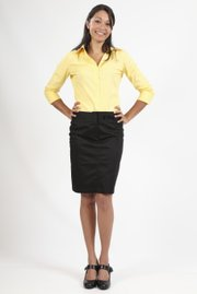 Wear shirts that are wrinkle-free and skirts that hit at the knees to the office.